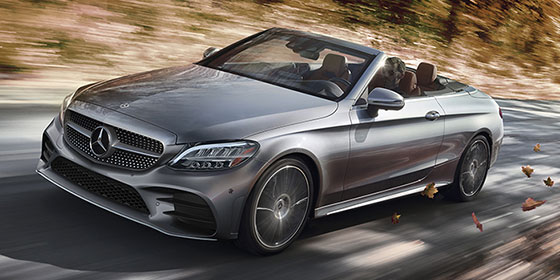 2019 C class Cabriolet with the top down driving on a road