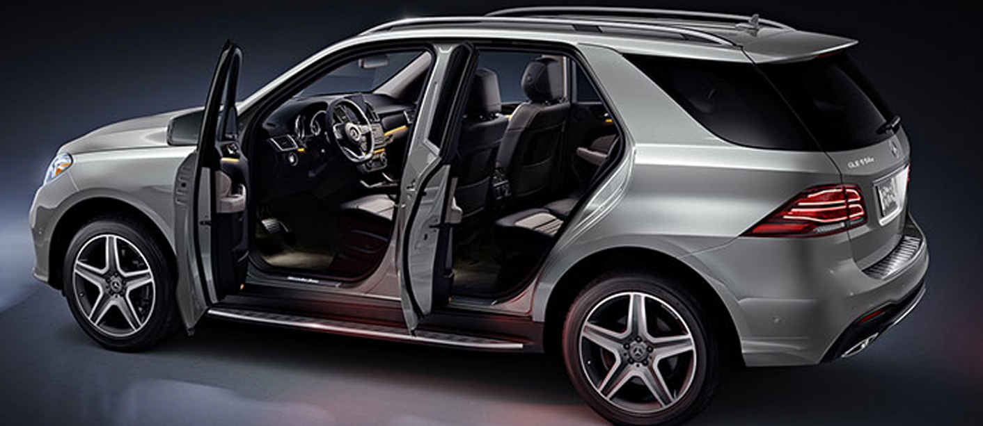 Side view of a silver GLE driver's side with front and back door open