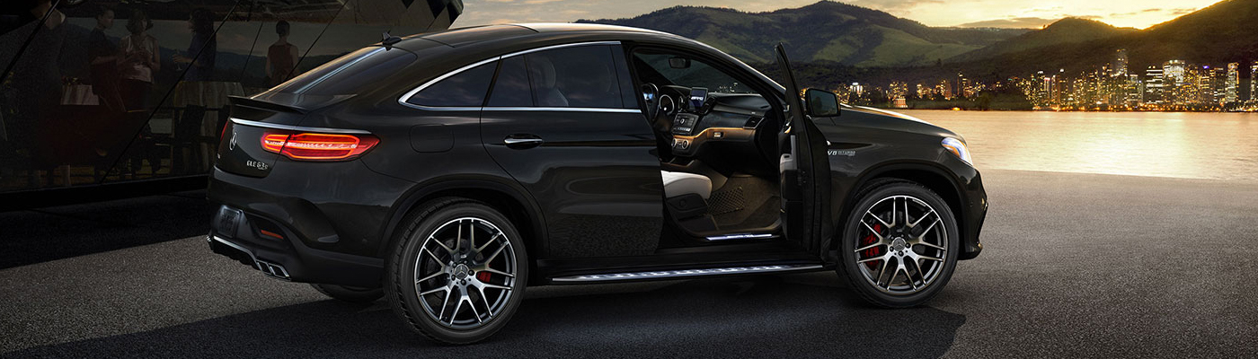 Black GLE Coupe parked in a driveway with the passenger door open
