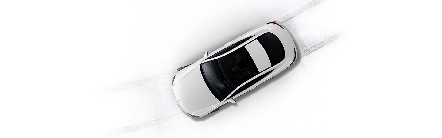 Top View of a white C-class Coupe driving on show