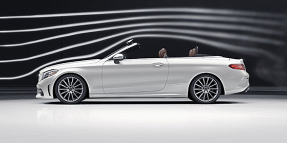 White C-Class Cabriolet with the top down.