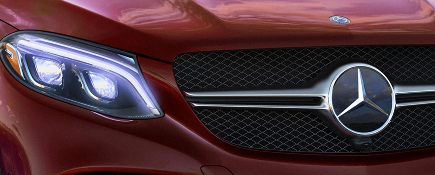 Grill and Mercedes logo on the front of a red GLE Coupe