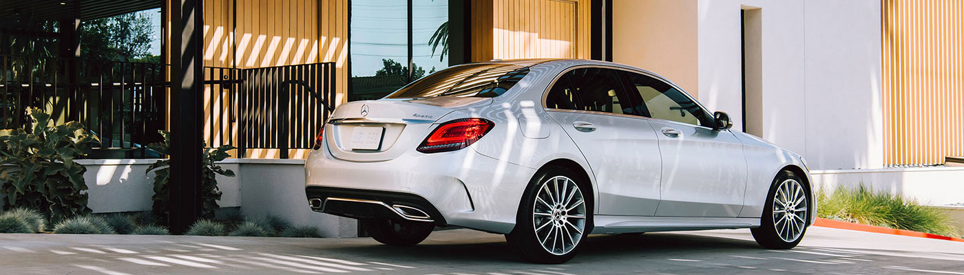 White 2019 C-class sedan rear view