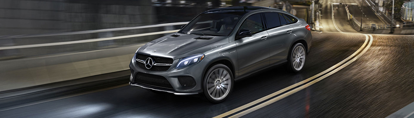 SIlver GLE Driving on a highway overpass