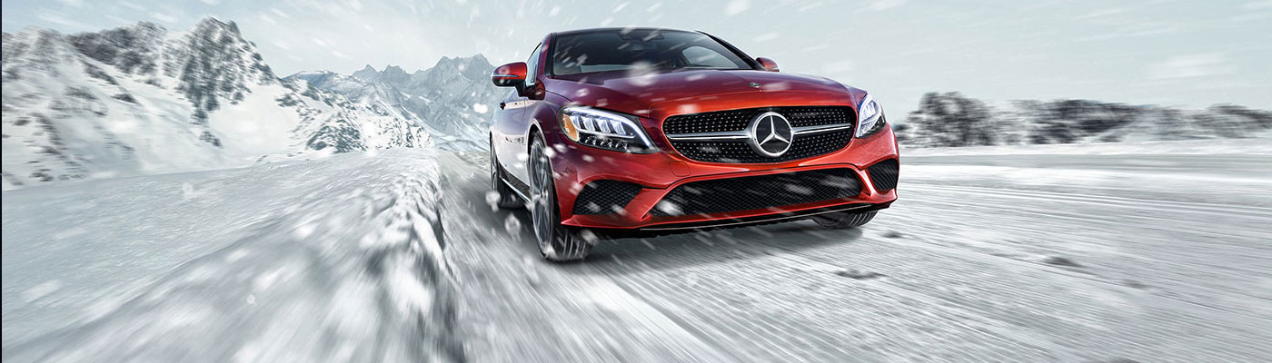 Red C-class coupe on winter road