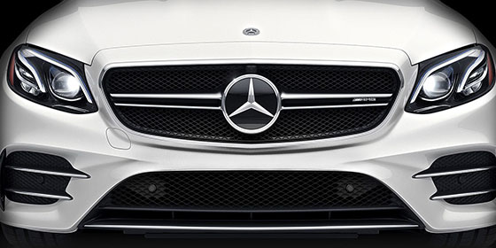 Grill with Mercedes Emblem on the front of a white E-class AMG Coupe