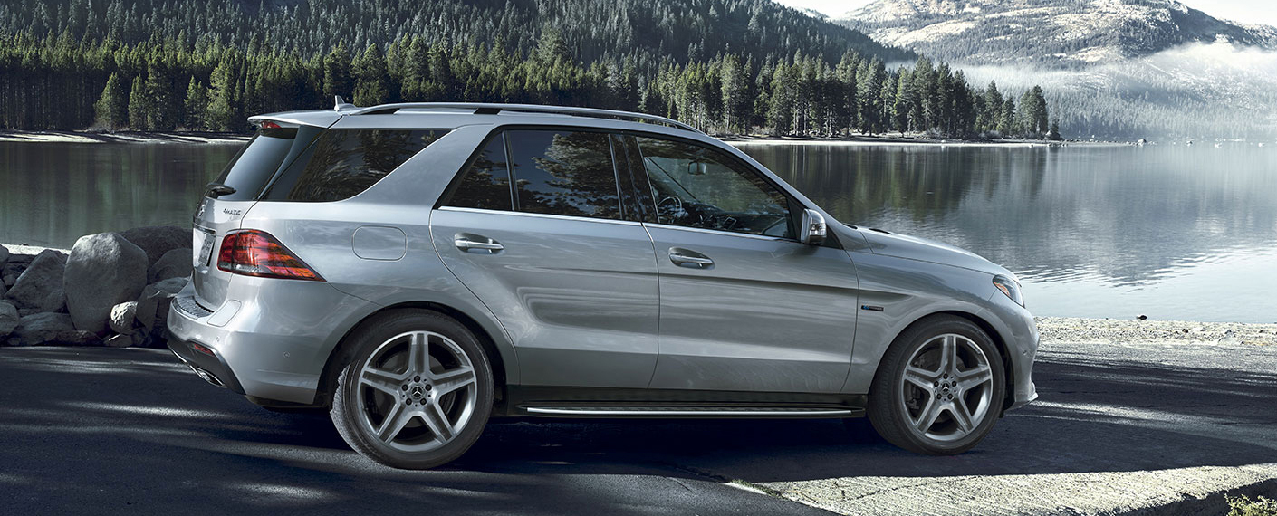 Side View of a silver GLE SUV parked by a lake