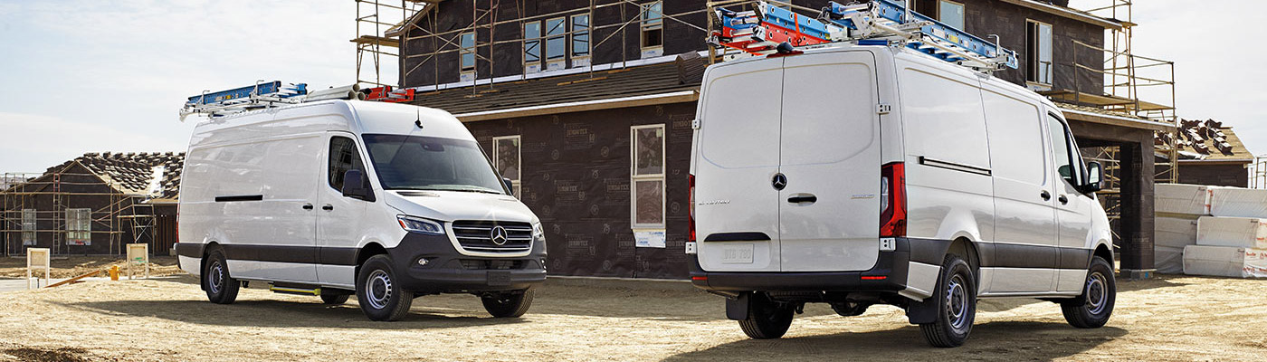 Two Sprinters Parked outside of a house frame