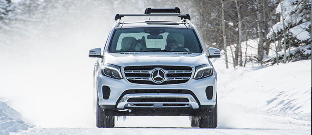 GLS SUV driving in the winter on a snow covered road