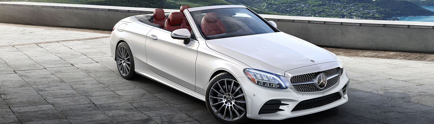 White c-class Cabriolet with the top down