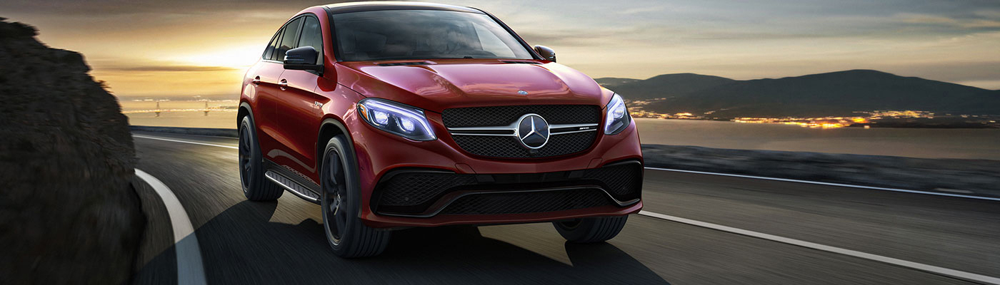 Red GLE Coupe driving on a highway