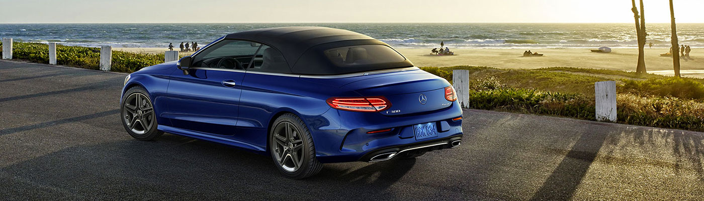 Back 3/4 rear view of a blue C-class
